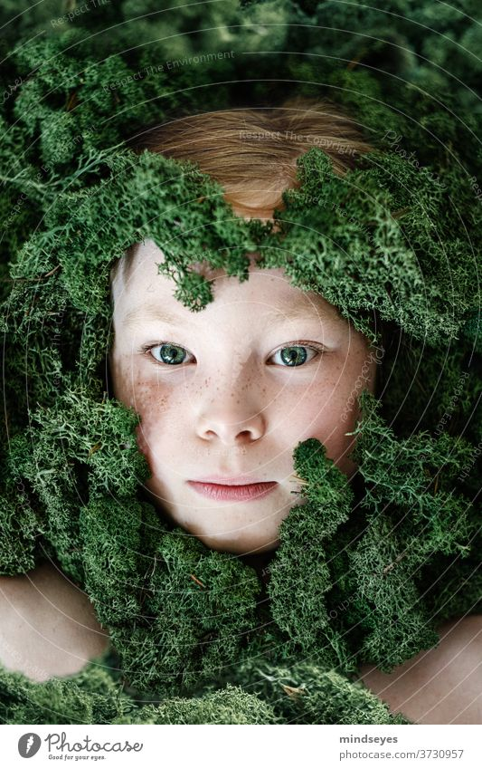 Girl in the moss Iceland Moss landscape portrait green creative portraits Freckles peer Hide Hiding place Nature Research Comprehend Elf Infancy girl silent