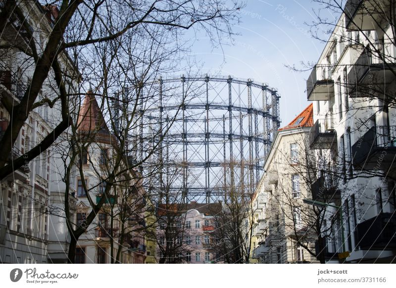 Gasometer in Schöneberg Architecture Landmark Historic Facade Housefront Residential area Cloudless sky bare trees Telescopic gas container