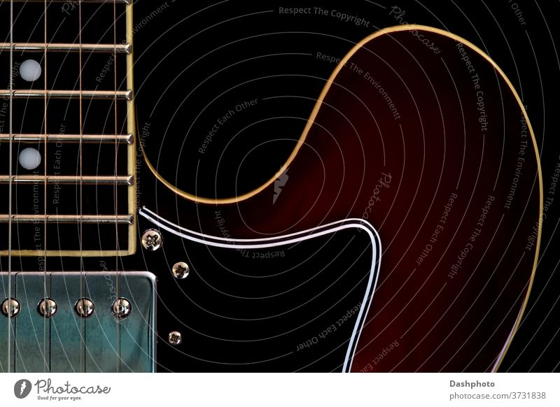 Electric Guitar Closeup View on a Black Background guitar electric electric guitar amplified semi acoustic semi acoustic guitar black red brown isolated object