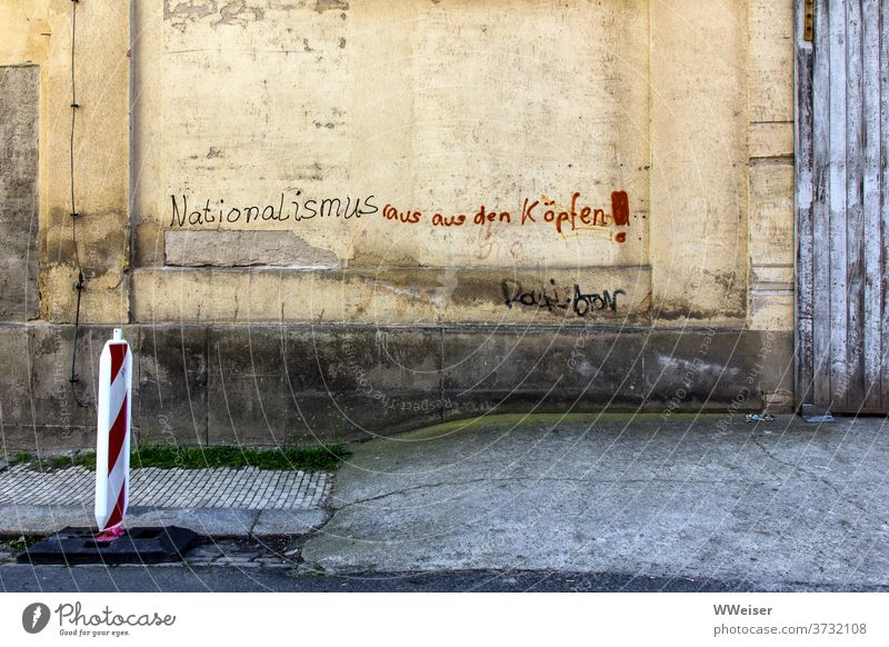 Nationalism out of your head! - demands the old house wall Wall (building) Wall (barrier) writing Slogan nationalism nazis out rights Nazis antifa Small Town