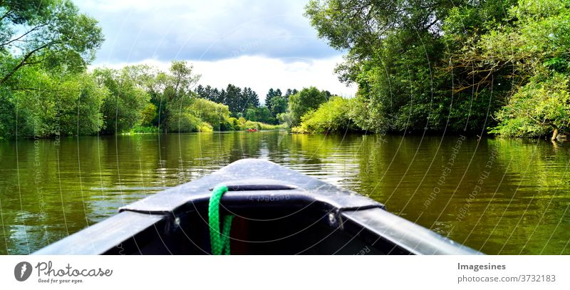 Canoeing through a river. Boat trip. Canoe on the river Lahn in Germany Adventure Beauty & Beauty Beauty in nature Blue boat canoeing Clouds in the sky