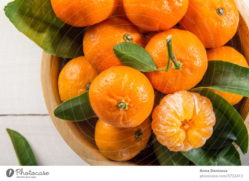 Delicious and beautiful mini Tangerines tangerine orange clementine mandarin citrus closeup ripe green healthy fresh sweet fruit organic juicy mandarine nature