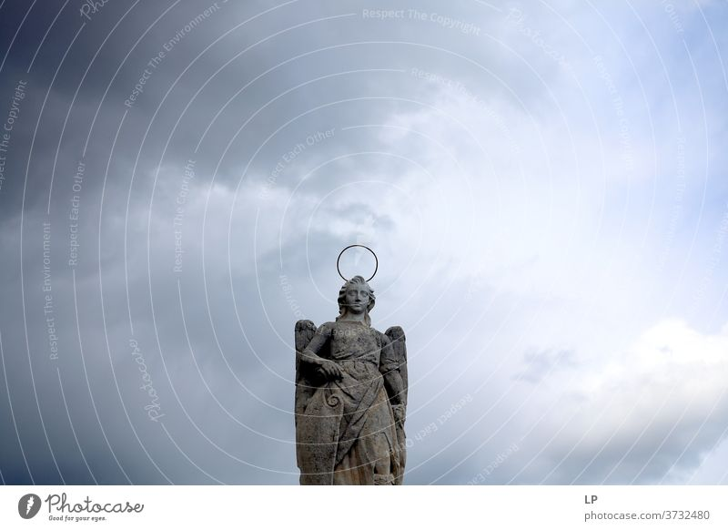 sculpture of a saint on a cloudy background Sculpture Rock wings Exterior shot Statue Religion and faith Architecture Culture Ancient Vacation & Travel Tourism