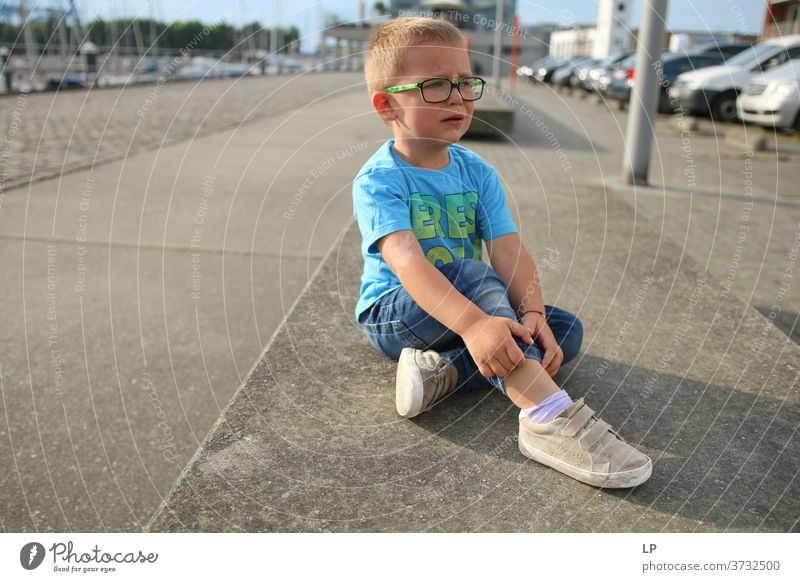 boywearing glasses ,crying on a bench upset Crisis Abandoned Left domestic violence Hit conflict management Bruised Hurt Equality Dignity tantrum