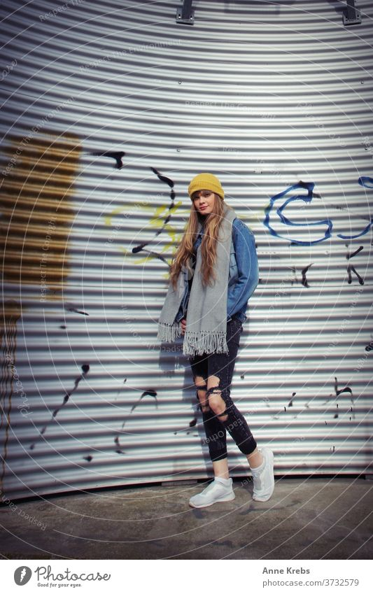 young woman in front of corrugated iron Woman girl street long hairs cap Yellow Blue Blonde Cool already Attractive Model Fashion pretty Human being