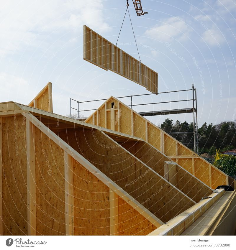 Timber construction construction site: Wall on crane Wooden house timber frame construction carpentry timber construction carpenter Construction site unfinished