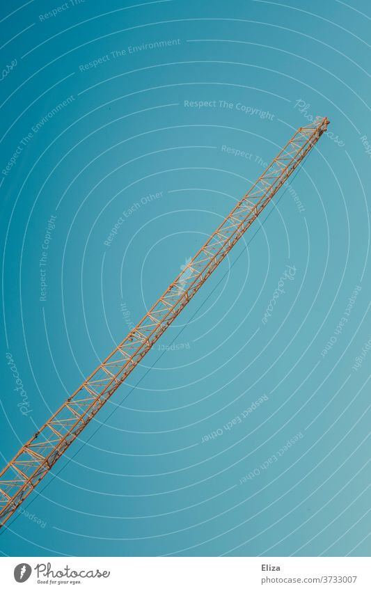 Construction crane in front of blue sky Crane crane arm Blue sky Build Construction site Yellow Industry Tall Sky Graphic Minimalistic