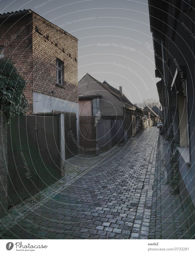 old town alley Alley Traffic infrastructure Gloomy door Facade Populated Cobblestones Remote Inhabited Right ahead Sidestreet Calm Cramped