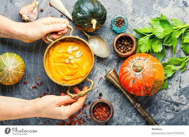 Pumpkin vegan soup pumpkin hands bowler autumn food vegetable cream healthy squash vegetarian creamy halloween rustic traditional diet eating herb fall puree