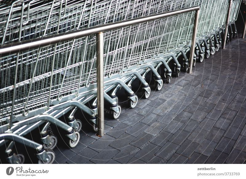 Shopping Cart purchasing Shopping Trolley Consumption Row SHOPPING Supermarket Provision weigh Metal Behind one another Steel pavement