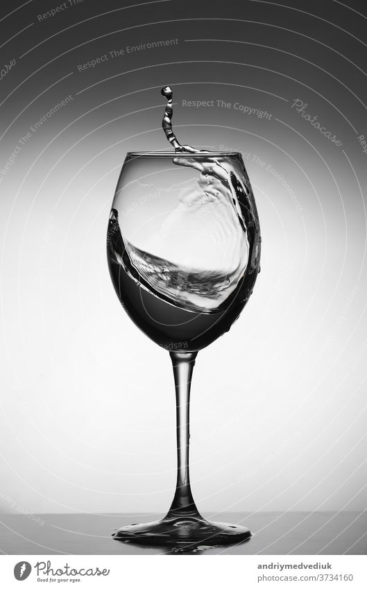 White wine splash on gray background. silhouette of a glass. selective focus drink white restaurant water object crystal liquid isolated thirsty beverage