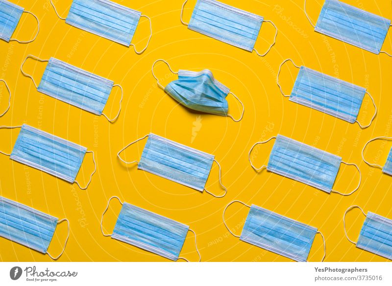 Medical masks isolated on a yellow background. Protective masks patterns above view air avoidance blue breath care clean concept corona coronavirus covid19