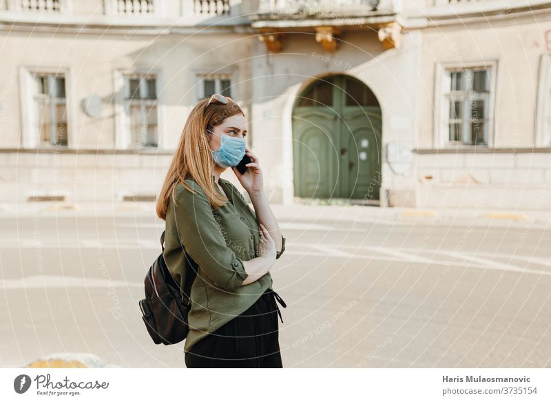 Young woman with mask talking on the phone outside in the city 2020 adult beautiful blue caffè caucasian child childhood concept coronavirus covid-19