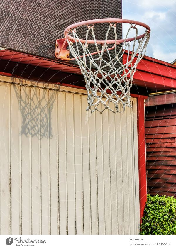Basketball ring with net, shadow, fixed to a wall Day Deserted Exterior shot Colour photo Town Basketball basket Wall (building) Beautiful weather