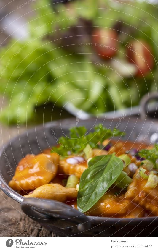 Ravioli in a copper casserole Bolognaise Bolognese Fresh salubriously Meal Eating Dinner Italian green herbaceous cake Diet Tortellini Vegetable Delicious