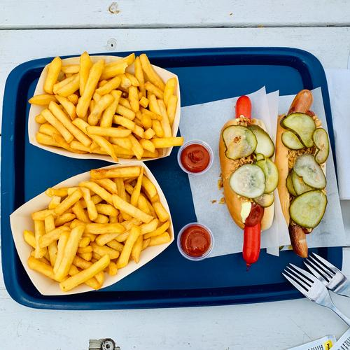 Hotdog with fries - stopover in Denmark Hot dog French fries fried onions Slices of cucumber Ketchup Fast food Fat Lunch Eating Sausage Delicious Snack bar