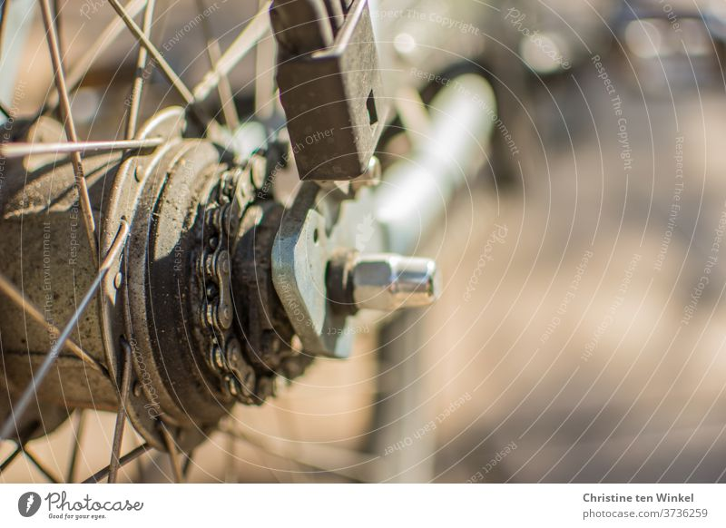 Bicycle. Close-up. Light. Shadow. Sunlight Detail Spokes Tire Glittering Reflection bicycle spokes bicycle hub Hub Chain Bicycle chain Old frowzy Wheel Metal