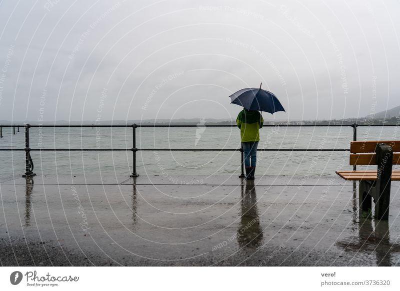 Sea umbrella rain promenade Copy Space top Landscape format Copy Space left Copy Space right Copy Space bottom Child Life Human being raindrop water Weather