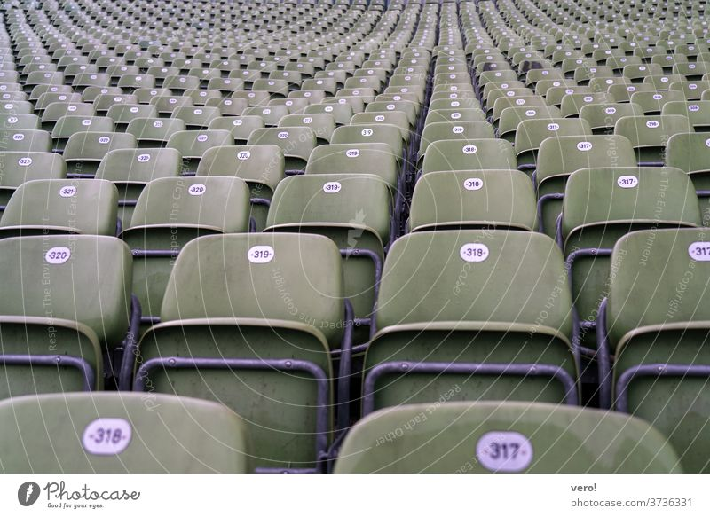 Armchair grandstand Downward Tall empty plastic seats Maximum Many bucket seats greenish good view Perspective Observe Deserted Row of seats Loneliness Empty