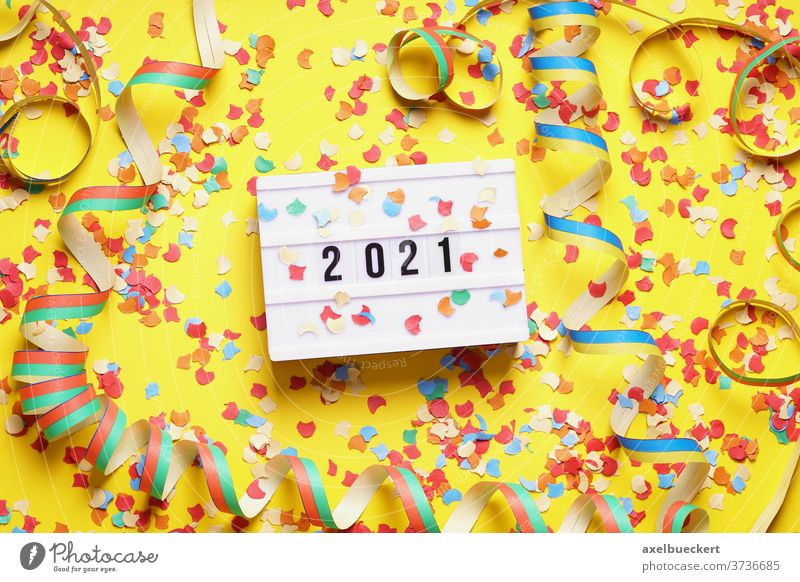 2021 new year celebration flat lay concept with confetti new years eve party paper streamer happy new year messy top view decoration background festive holiday