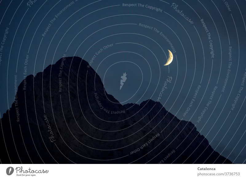 Moon over Wettersteinspitze mountain mountains Peak Night Sky conceit Evening Blue Yellow Black Night sky Rock outline