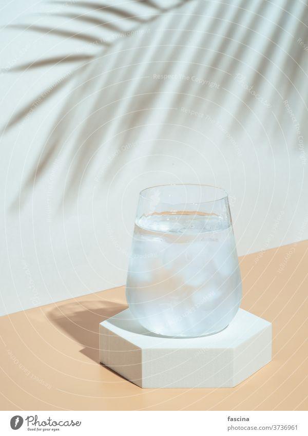 Modern still life with cold water glass drink mockup beverage stylish ice minimalism mock up pedestal tropical tumbler hexagon fashion trendy geometric shape