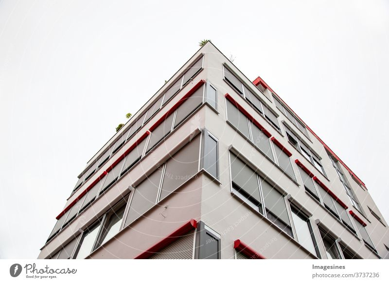 Facade of city apartments with roof terrace. Corner apartment complex. Modern architecture, residential building Flat (apartment) condominium built Architecture