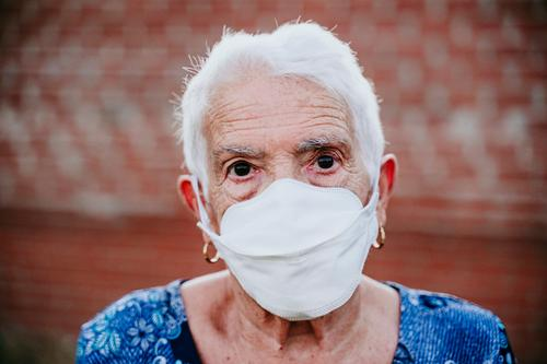 portrait of old lady wearing protective mask. new normal corona virus elder 80s grandmother woman elderly home white hair grey hair mental aged health care