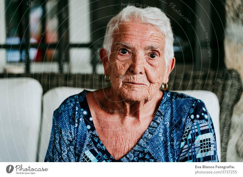 portrait of old lady in her 80s relaxed at home. woman elderly garrotte white hair grey hair mental solitude thoughtful grandmother aged health care looking