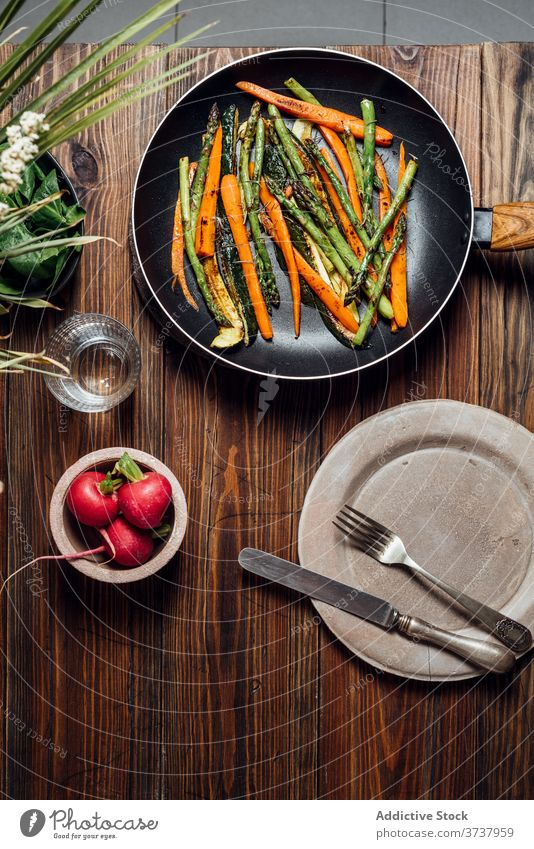 Carrot, asparagus and zucchini sauteed in the pan, on the table gourmet carrots concept modern mix new traditional background prepared recipe rustic vegetarian