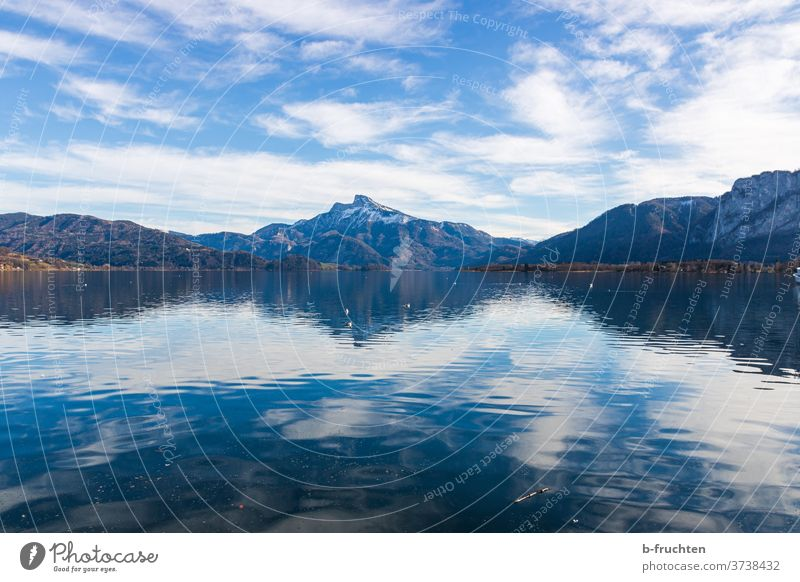 Lake with view of the mountains, Mondsee, Salzkammergut, Austria Mountain Clouds Sky Snow Alps Blue Vantage point Hiking moon lake Water Calm sheep's mountain