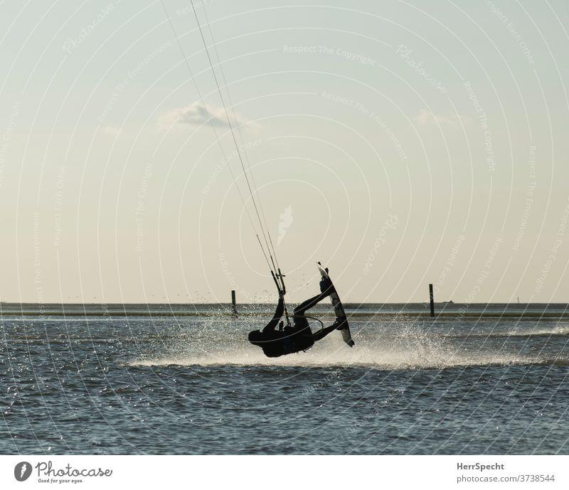 Kite surfers in the air kitesurfer Kitesurfing Ocean Water Waves Summer Vacation & Travel Aquatics Summer vacation Coast Exterior shot Tourism