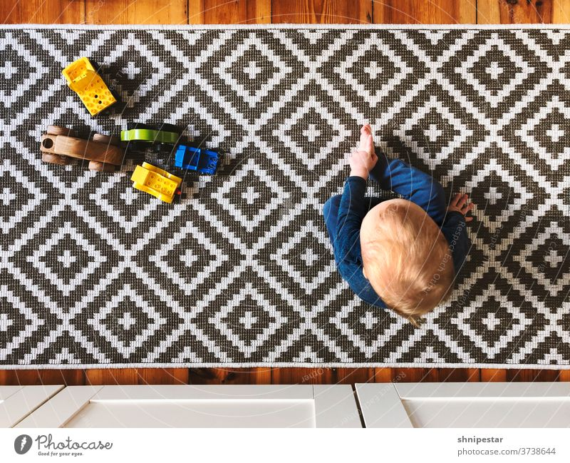 Top view of a sitting infant plan Carpet Toys LEGO duplo Toddler Baby Boy (child) Son Father Pattern pattern tiles Tile carpet pattern Runner cake Infancy