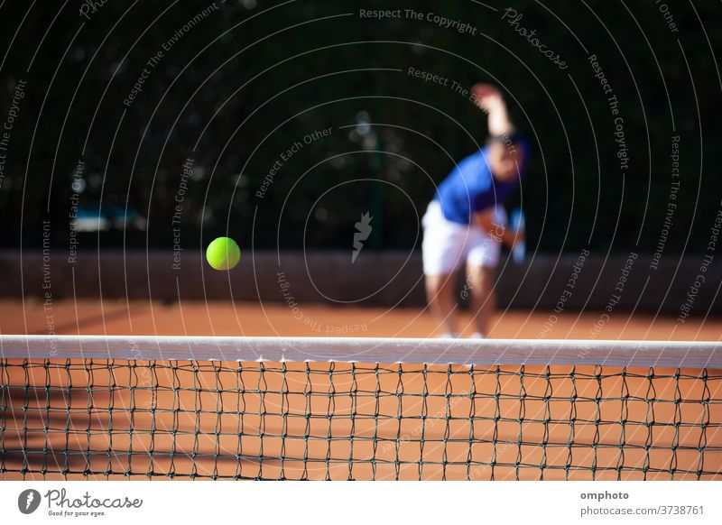 Tennis ball just over the net after powerful first serve of a player tennis court hitting shoot ace win game set competition point score sport racquet racket