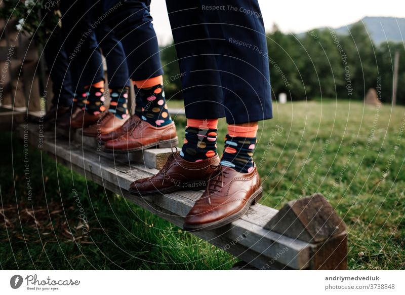 stylish men's socks. Stylish suitcase, men's legs, multicolored socks and new shoes. Concept of style, fashion, beauty and vacation mens socks luxury groom