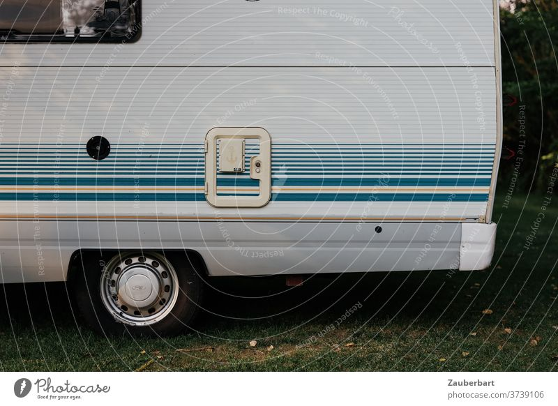 Side view of a motorhome with blue stripes Mobile home Caravan Wheel Stripe Blue side view Camping Camping site vanlife caravan vacation voyage Tourism overflow