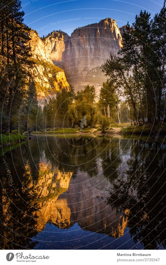 El Capitan lit by the first sun-rays in the morning short after sunrise, Yosemite National Park, California USA california orange golden park national usa