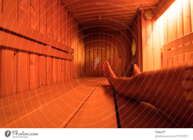 a wooden sauna from the inside with a man taking a sauna hot warm modern sauna modern wooden sauna sauna oven light relax take a sauna sauna inside