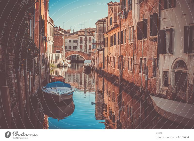 A small canal in Venice Channel Water Small atmospheric boats Italy Tourism Tourist Attraction Town Old town Narrow bridge houses romantic