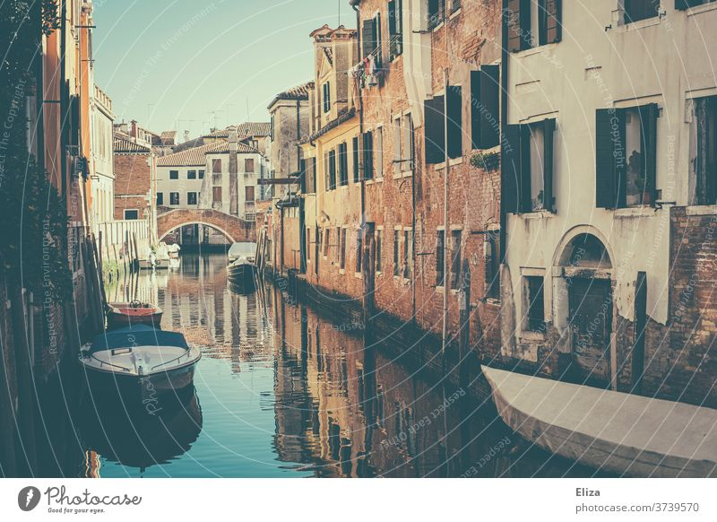 A small canal with boats in Venice Channel bridge houses Deserted Old town Italy Facade Water built Picturesque already Day Town reflection City trip