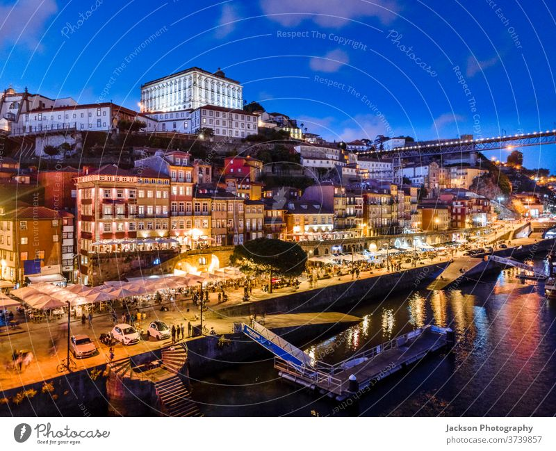 Historic architecture by Douro river in Porto, Portugal porto portugal cityscape evening bridge nature douro luis night boat house old ribeira old town houses