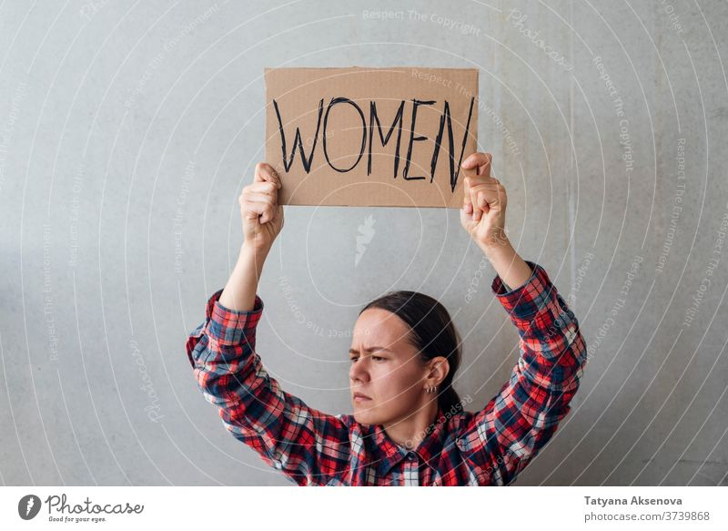 Woman activist with poster women rights banner demonstration protest people politics human gender street community equality female protester sign demonstrator