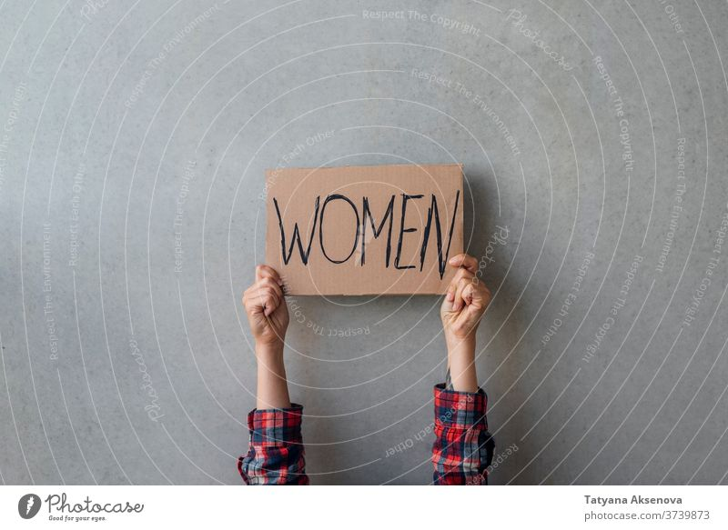 Woman activist hands with poster women rights banner demonstration protest people politics human gender street community equality female protester sign