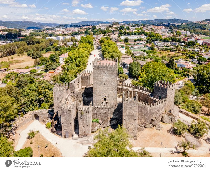 Aerial view of castle of Guimaraes, Portugal guimaraes portugal cityscape aerial town old tourism unesco world heritage palace cultural historical