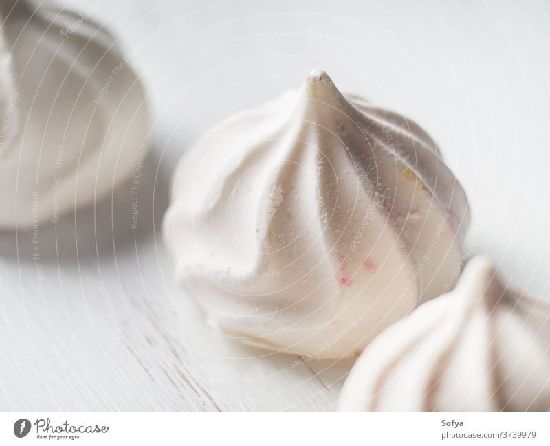 White meringue macro on wooden board white food winter texture birthday art cake dessert gourmet pastry plate dish homemade sweet color cook bake candy eating