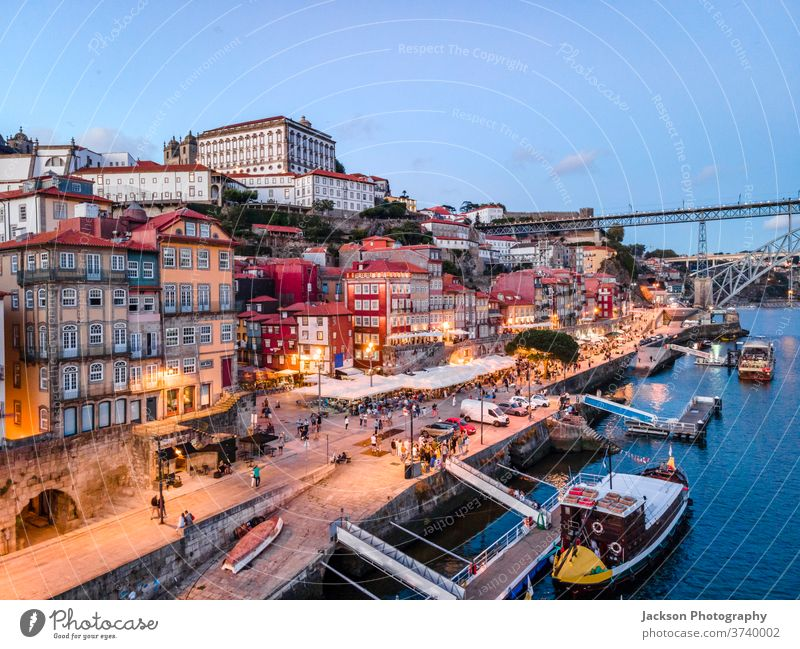 Historic architecture by Douro river in Porto, Portugal porto portugal cityscape bridge nature douro evening luis night boat house old ribeira old town houses
