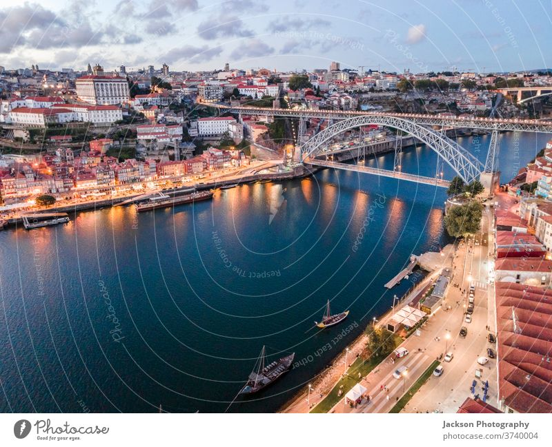 Aerial cityscape of Porto and Vila Nova da Gaia with connecting bridge, Portugal porto gaia night vila nova da gaia luis boat house portugal architecture old