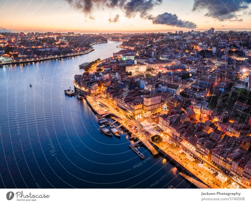 Aerial view of city center of Porto at the evening, Portugal douro porto portugal aerial cityscape ribeira night boat house architecture old windows old town
