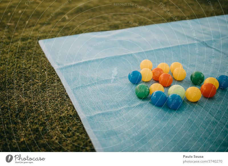 Colorful balls on the grass colorful colored Grass Toys Ball child holiday kid beautiful spring background decoration art fun education Kindergarten preschooler