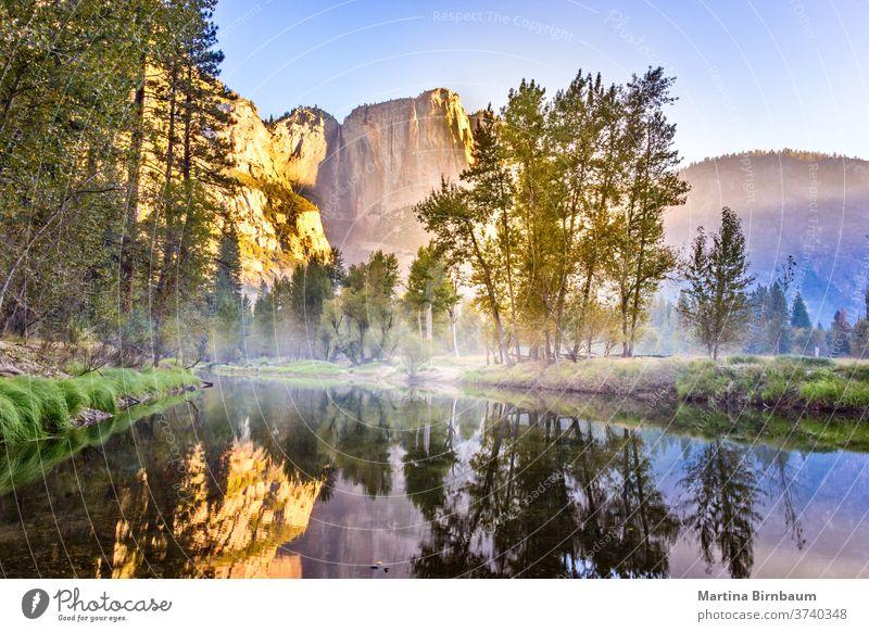 El Capitan reflecting in a lake in the morning short after sunrise, Yosemite National Park, California USA california orange golden park national usa yosemite